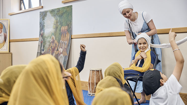 Children learn how to tie turban at gurdwara